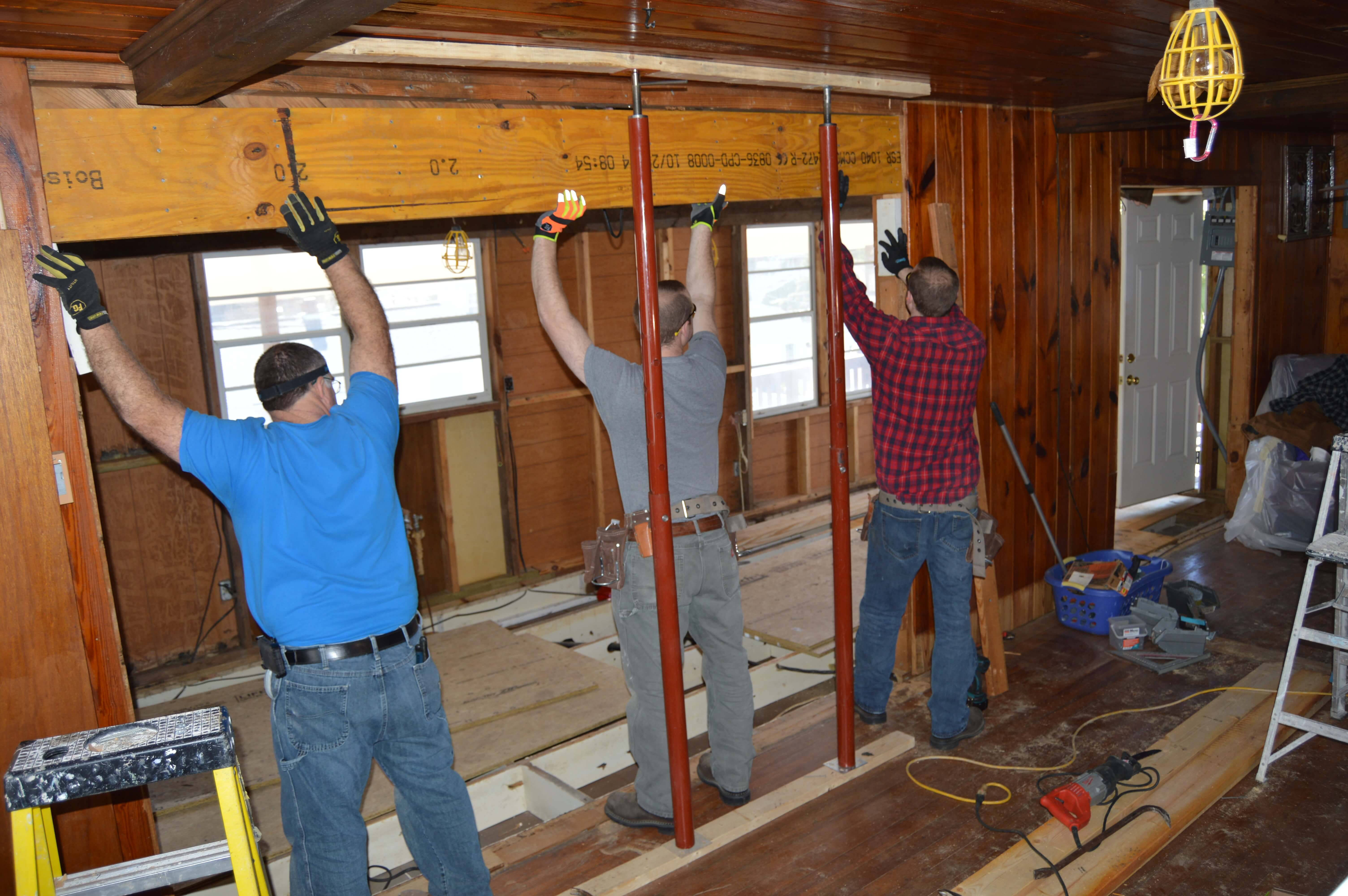 contractors hanging support beam