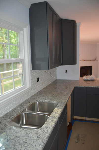granite countertops and tile backsplash