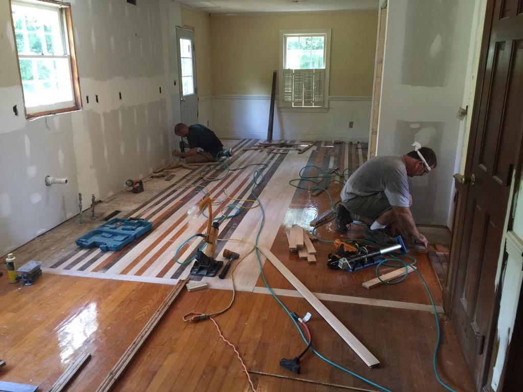 Ben & Pat installing floors