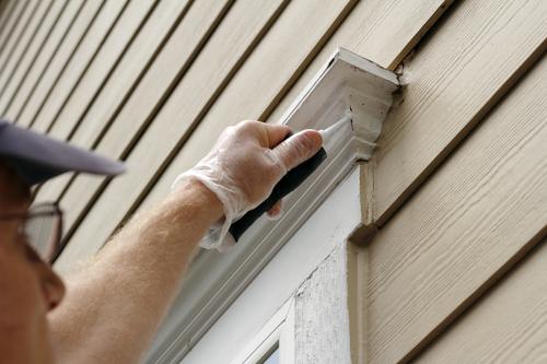 Contractor Sealing Window