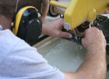 tile saw with ear protection