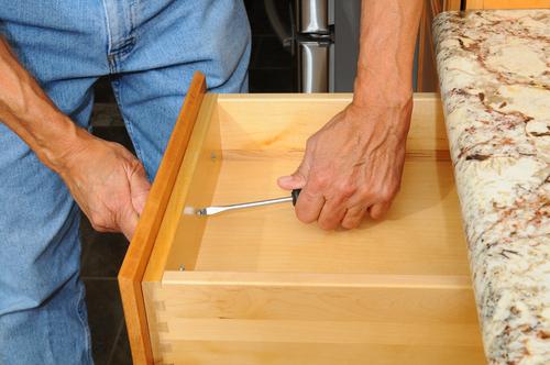 Cabinet Insataller Working on Drawer
