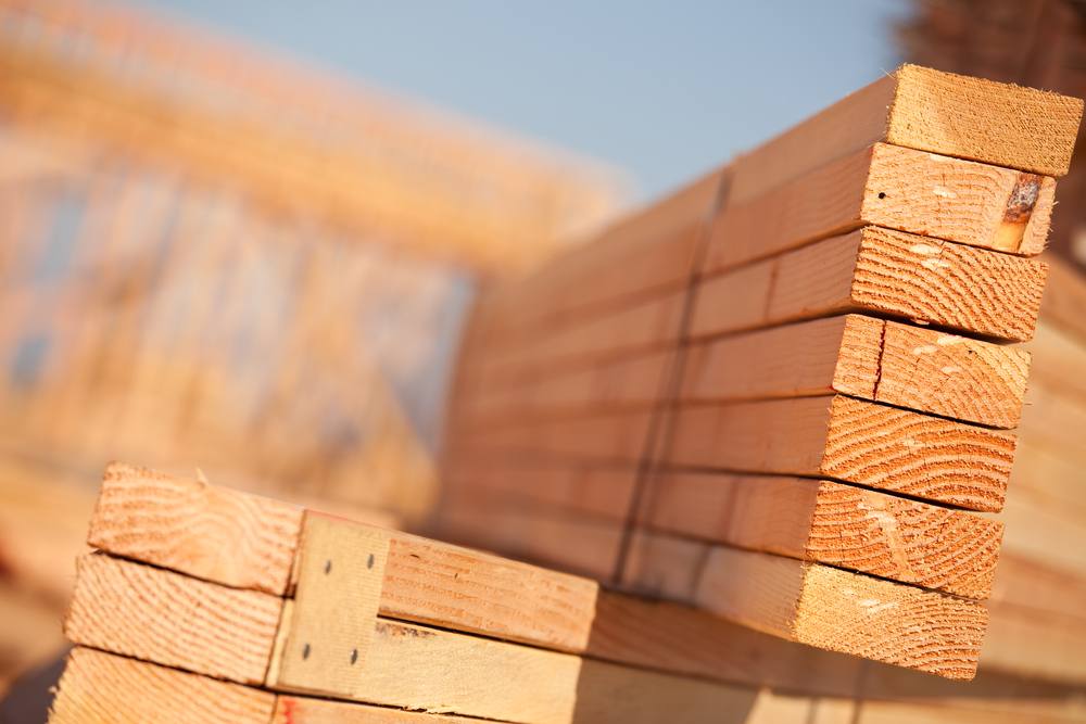 stack of lumber signifying rising prices